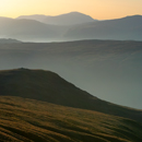 Sunset view from Raise in February across Watendleth Fell and the Borrowdale Fells to Pillar mountain