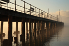 Sun breaking through morning mist, Pooley Bridge Old Pier, Ullswater in winter