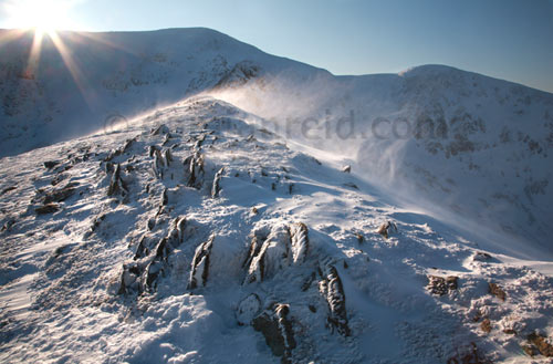 Swirral Edge Helvellyn, ice, sun, spindrift and rocks, Lake District