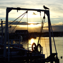 Sunset over fishing boats in Amble Harbour